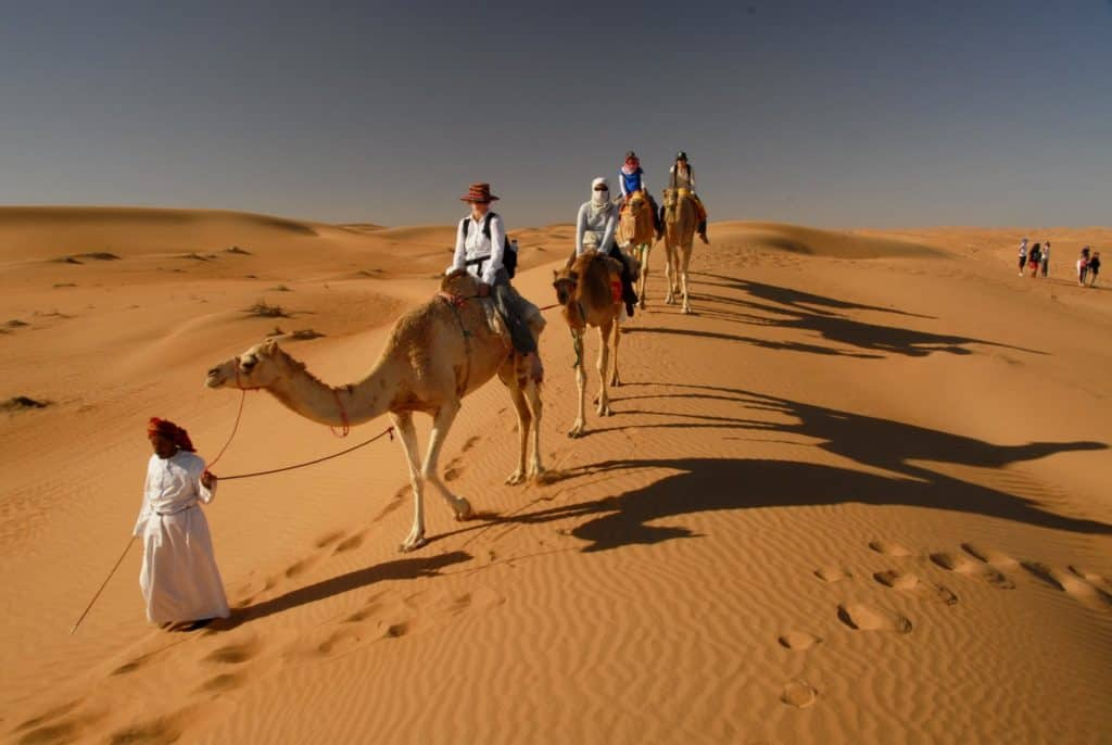 Camel_riding_at_Wahiba_Sands